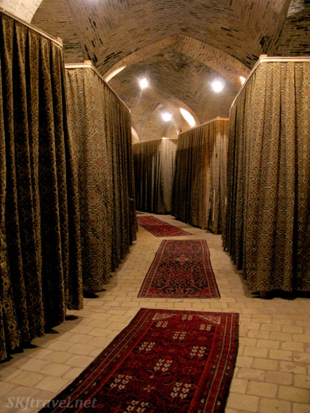 """Caravansary turned into a hotel, the """"rooms"""" consist of a raised bed behind each curtain."""
